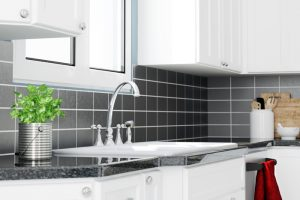 Sink with faucet in clean white modern kitchen (3D Rendering)
