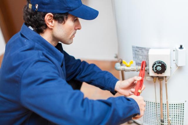 Plumber Installs Water Heater